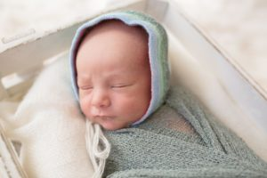 posed melbourne newborn photography colour photo baby boy face